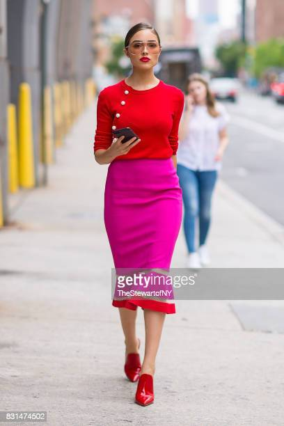 Olivia Culpo is seen wearing an Altuzarra sweater Emanuel Ungaro skirt Gianvito Rossi shoes and Linda Farrow sunglasses in SoHo on August 14 2017 in...