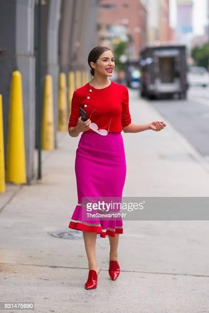 Olivia Culpo is seen wearing an Altuzarra sweater Emanuel Ungaro skirt Gianvito Rossi shoes and Linda Farrow sunglasses in SoHo on August 14 2017 in...