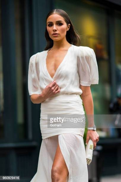 Olivia Culpo is seen wearing an Eloshi dress with Gianvito Rossi shoes and a Dior hangbag in Chelsea on April 24 2018 in New York City