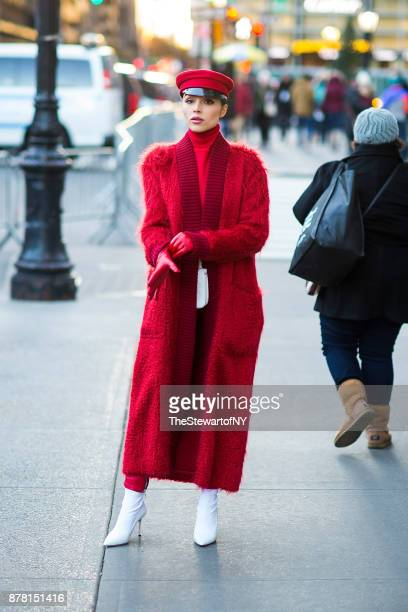 Olivia Culpo is seen wearing Max Mara with Jimmy Choo shoes and a Chanel belt bag in Midtown on November 23 2017 in New York City