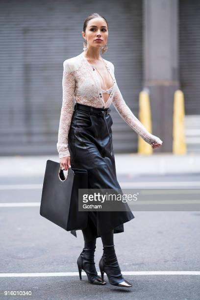 Olivia Culpo is seen wearing Nina Ricci with a Salvatore Ferragamo handbag in SoHo on February 8 2018 in New York City