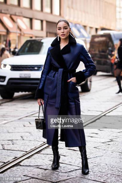 Olivia Culpo, wearing a blue coat, is seen outside Blumarine on Day 3 Milan Fashion Week Autumn/Winter 2019/20 on February 22, 2019 in Milan, Italy.
