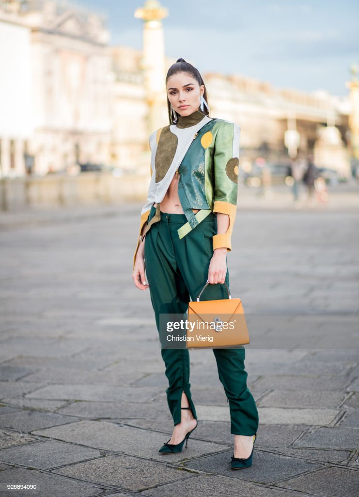 Olivia Culpo wearing Ronald van der Kemp pants and jacket, Valextra bag, Nina Ricci shoes, Jennifer Fisher jewelry seen during Paris Fashion Week Womenswear Fall/Winter 2018/2019 on March 3, 2018 in Paris, France.