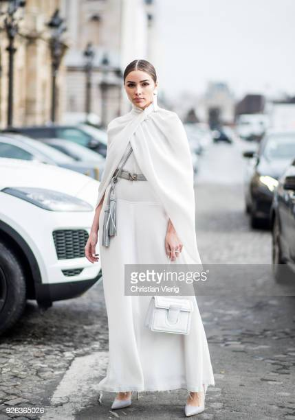 Olivia Culpo wearing white Nina Ricci skirt belt and top Ferragamo bag Casadei heels Maria Black jewelery on March 2 2018 in Paris France