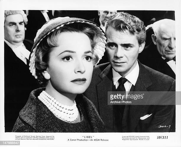 Olivia de Havilland and Dirk Bogarde in a scene from the film 'Libel', 1959.