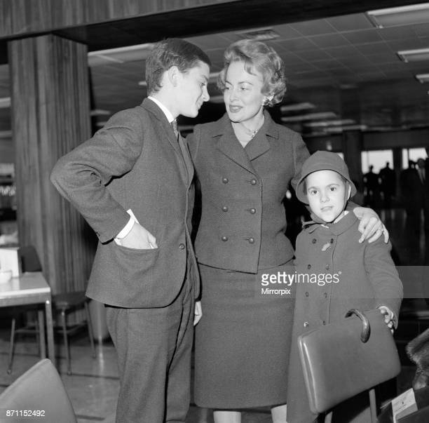 Olivia De Havilland at London Airport with her children Benjamin and Gisele waiting for a flight home to Paris 15th April 1964