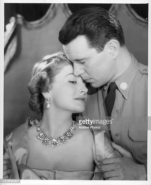 Olivia deHavilland and John Forsythe embrace in a scene from the film 'The Ambassador's Daughter' 1956