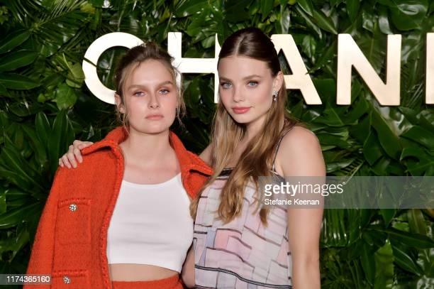 Olivia DeJonge and Kristine Froseth bothwearing CHANEL attends Chanel Dinner Celebrating Gabrielle Chanel Essence With Margot Robbie on September 12...