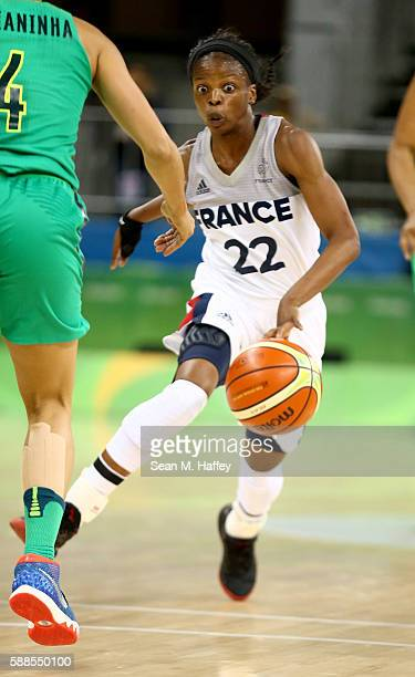 Olivia Epoupa of France dribbles upcourt against Brazil during a Women's Preliminary Group B match on Day 6 of the Rio 2016 Olympics at the Youth...