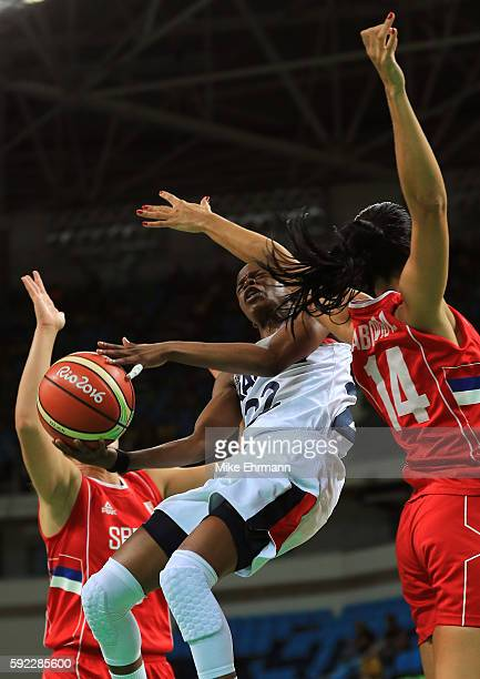Olivia Epoupa of France shoots against Ana Dabovic of Serbia during the Women's Bronze Medal basketball game between France and Serbia on Day 15 of...