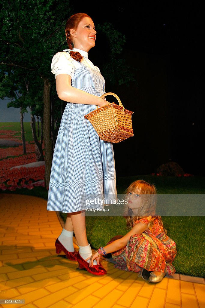 Olivia Fajnerman, four-years-old, takes a closer look at a waxwork Judy Garland as Dorothy inside the 'The Wizard of Oz' 4-D experience at Madame Tussauds on July 13, 2010 in New York City.