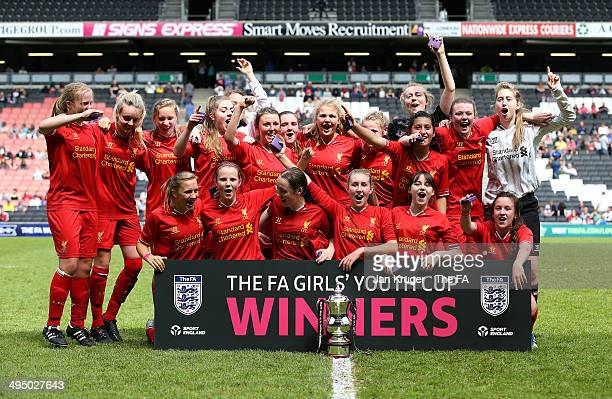Olivia Fuller and her Liverpool Ladies team celebrate with the trophy during the FA Girl's Youth Cup final between Everton Ladies and Liverpool...