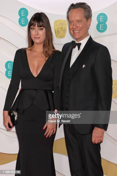 Olivia Grant and Richard E Grant arrive at the EE British Academy Film Awards 2020 at Royal Albert Hall on February 2 2020 in London England