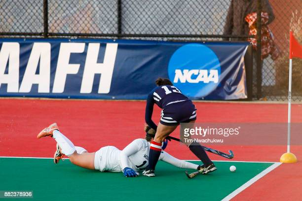Olivia Green of Middlebury College blocks Nicole Wilkerson of Messiah College during the Division III Women's Field Hockey Championship held at...