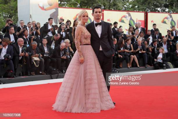 Olivia Hamilton and Damien Chazelle walk the red carpet ahead of the opening ceremony and the 'First Man' screening during the 75th Venice Film...