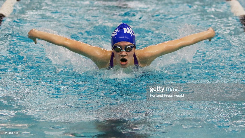 Olivia Harper competes in the 100 yard butterfly with a time of 56.35 seconds in the Class B girls swimming championships at Bowdoin College.