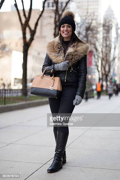 Olivia Hill is seen on Michigan Avenue wearing a brown/black leather Michael Kors bag and boots fir/leather River Island coat and black River Island...