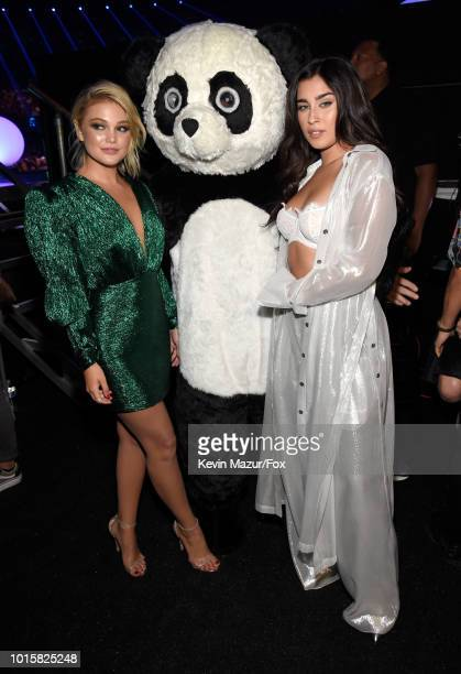 Olivia Holt and Lauren Jauregui attend FOX's Teen Choice Awards at The Forum on August 12 2018 in Inglewood California