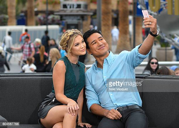 Olivia Holt and Mario Lopez visit 'Extra' at Universal Studios Hollywood on September 13 2016 in Universal City California