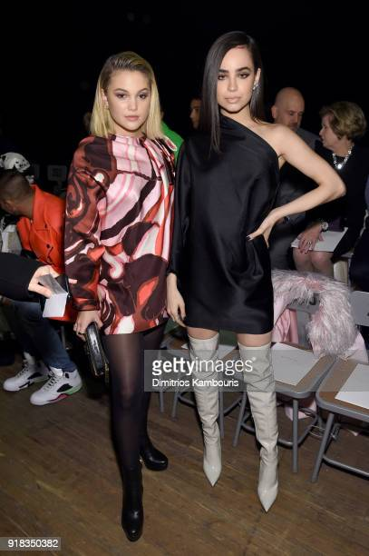 Olivia Holt and Sofia Carson attend the Marc Jacobs Fall 2018 Show at Park Avenue Armory on February 14 2018 in New York City