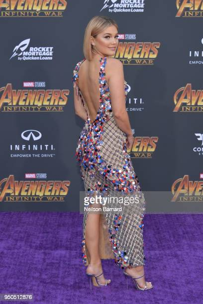 Olivia Holt arrives at the Premiere Of Disney And Marvel's 'Avengers Infinity War' on April 23 2018 in Los Angeles California