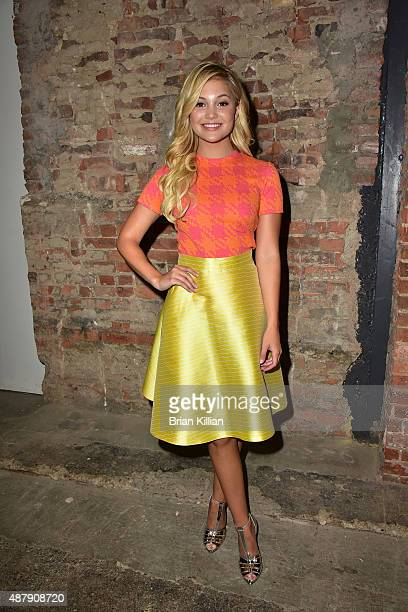 Olivia Holt poses backstage just before the start of the Christian Siriano show during Spring 2016 New York Fashion Week at ArtBeam on September 12...
