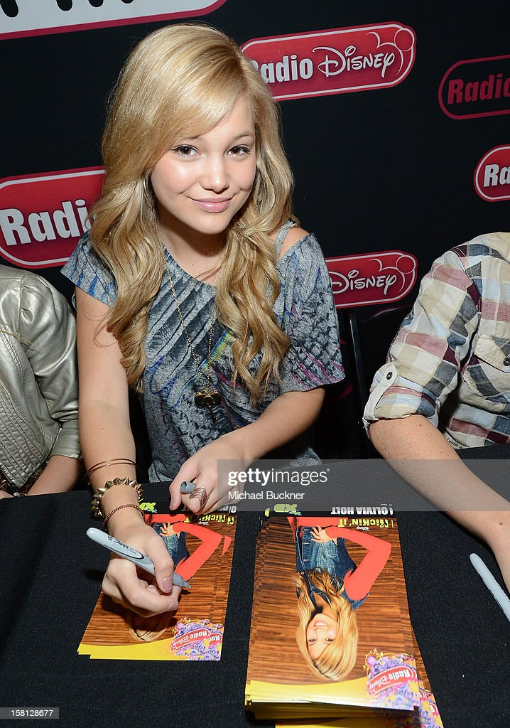 Olivia Holt star of the hit series 'Jessie' gets signs autographs for Radio Disney AM 1110 fans at the Wii U Showdown at Westfield Century City Mall in Los Angeles on December 9, 2012. Wii U is one of Nintendo's hottest items of the holiday season.