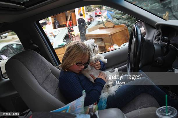 Olivia Holzhauer hugs her family dog Miley after she walked home from school to find her family evicted and belongings removed to the front lawn on...