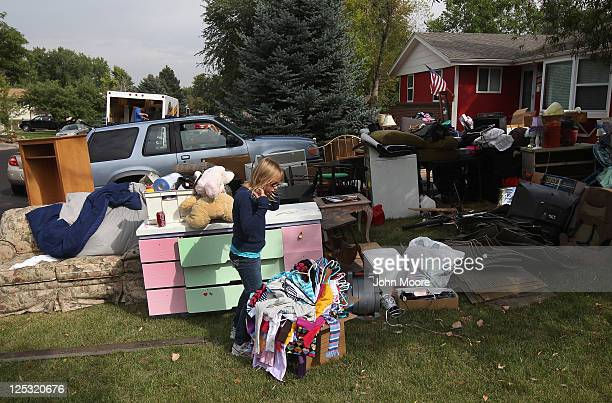 Olivia Holzhauer retrieves clothing after she arrived home from school to find her family evicted and belongings removed to the front lawn on...