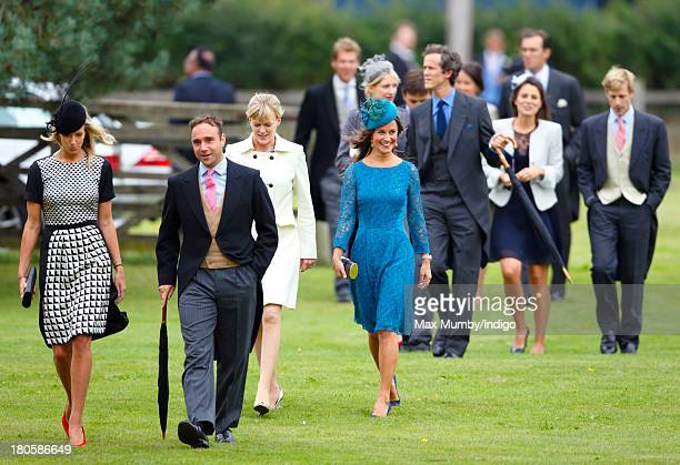 Olivia Hunt and Pippa Middleton attend the wedding of James Meade and Lady Laura Marsham at the Parish Church of St Nicholas in Gayton on September...
