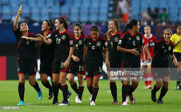 Olivia Jimenez of Mexico celebrate with her team mates after she scores her team's 2nd goal during the FIFA U20 Women's World Cup 2012 group A match...