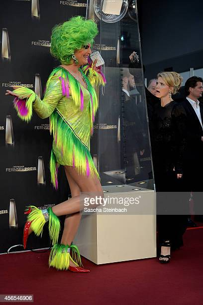 Olivia Jones and Annette Frier arrive at the 'Deutscher Fernsehpreis 2014' at Coloneum on October 2 2014 in Cologne Germany