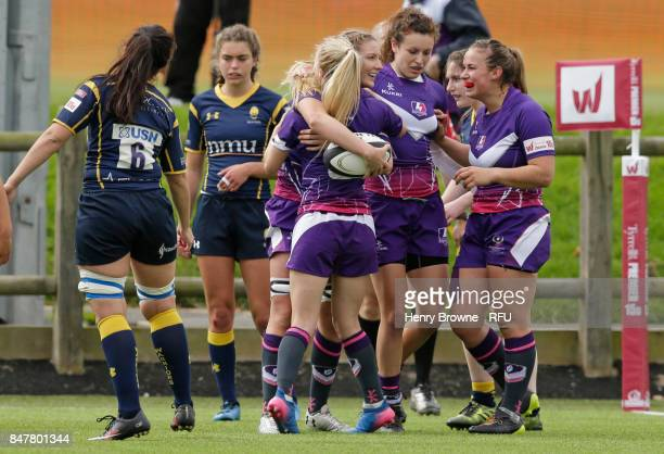 Olivia Jones of Loughborough Lightning celebrates with team mates after scoring a try during the Tyrrells Premier 15's match between Loughborough...
