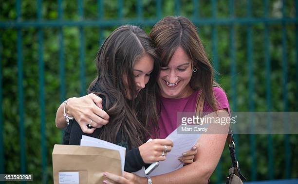 Olivia Katie is congratulated by her mother as she opens her Alevel results at Winterbourne International Academy on August 14 2014 in Bristol...