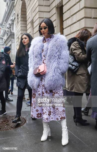 Olivia Lazuardy is seen wearing a lavender Sevange coat and Kate Spade dress on the street during New York Fashion Week on February 8, 2019 in New...