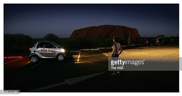 Olivia McLean watches the sun go down over Uluru after she arrived in her smart car during the The World Solar Car Challenge from Darwin to Adelaide...