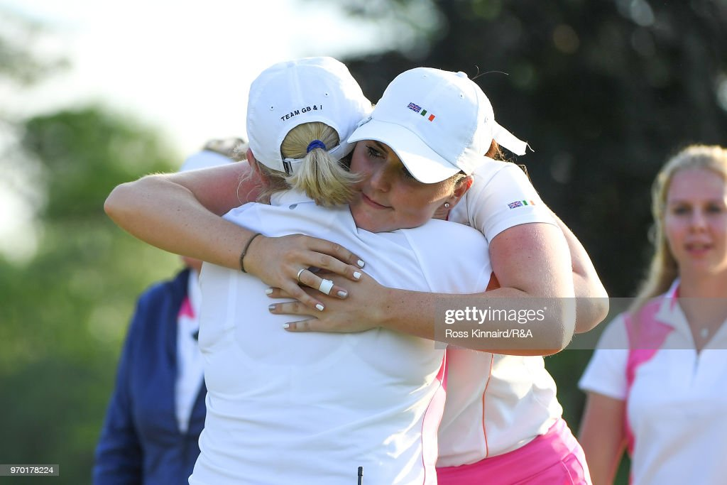 Olivia Mehaffey of Great Britian & Ireland hugs captain Elaine Farquharson-Black during foursomes matches on day one of the 2018 Curtis Cup at Quaker Ridge Golf Club on June 8, 2018 in Scarsdale, New York.