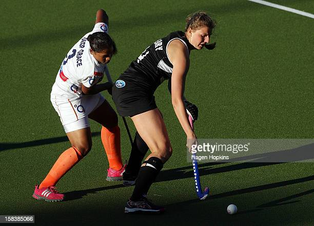 Olivia Merry of New Zealand controls the ball as Deep Grace Ekka of India looks on during the match between New Zealand and India at the National...