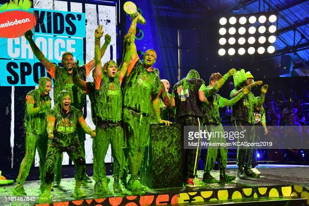 Olivia Moultrie Laurie Hernandez Ben Simmons David Dobrik Rob Gronkowski Lindsey Vonn Shaun White and Kel Mitchell react after being slimed onstage...