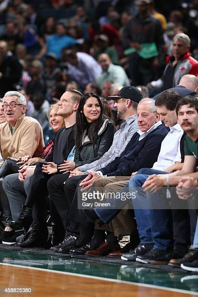 Olivia Munn Aaron Rodgers and AJ Hawk of the Green Bay Packers during the game between the Oklahoma City Thunder and Milwaukee Bucks on November 11...