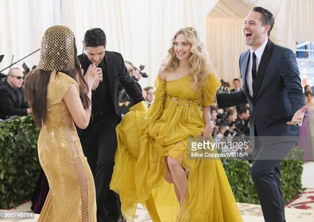 Olivia Munn Amanda Seyfried and Thomas Sadoski attend the Heavenly Bodies Fashion The Catholic Imagination Costume Institute Gala at The Metropolitan...