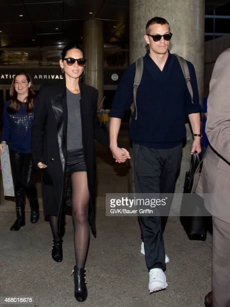 Olivia Munn and Joel Kinnaman are seen at LAX airport on February 08, 2014 in Los Angeles, California.