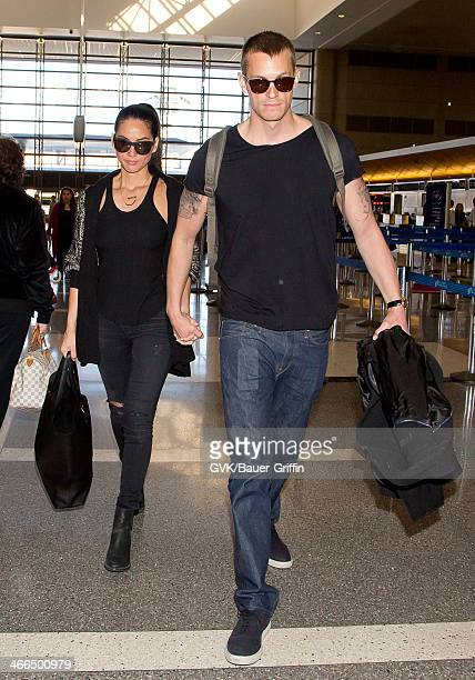Olivia Munn and Joel Kinnaman are seen at Los Angeles International airport on February 01, 2014 in Los Angeles, California.