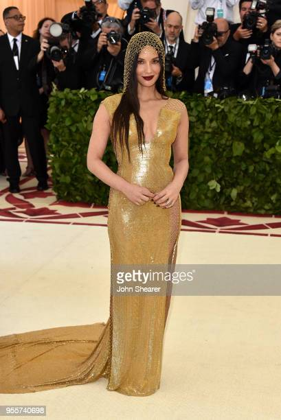 Olivia Munn attends the Heavenly Bodies Fashion The Catholic Imagination Costume Institute Gala at The Metropolitan Museum of Art on May 7 2018 in...