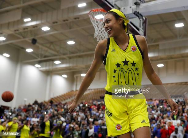 Olivia NelsonOdoda of WinderBarrow High School reacts after dunking during the 2018 McDonald's All American Game POWERADE Jam Fest at Forbes Arena on...