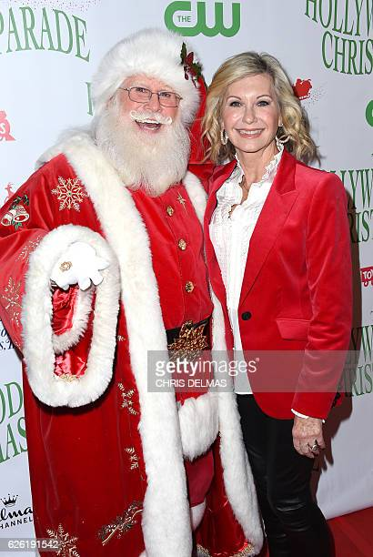 Olivia Newton John and Santa Claus attend the 85th annual Hollywood Christmas parade on Hollywood Boulevard in Hollywood, on November 27, 2016. / AFP...