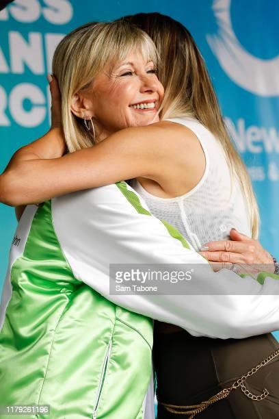 Olivia Newton John hugs daughter Chloe Lattanzi attends the Olivia NewtonJohn Wellness Walk and Research Run on October 06 2019 in Melbourne...