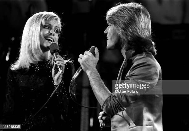Olivia NewtonJohn and Andy Gibb perform on stage at Music for UNICEF Concert at The United Nations in New York on January 9 1979