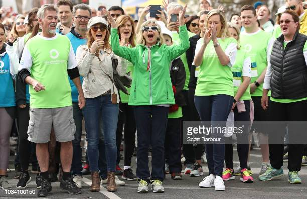 Olivia NewtonJohn and her husband John Easterling along with Tottie Goldsmith and Melissa Doyle hold hands as they begin the walk during the annual...