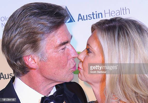 Olivia NewtonJohn and her husband John Easterling kiss as they arrive at the inaugural ONJ Gala to raise funds for the Olivia NewtonJohn Cancer...